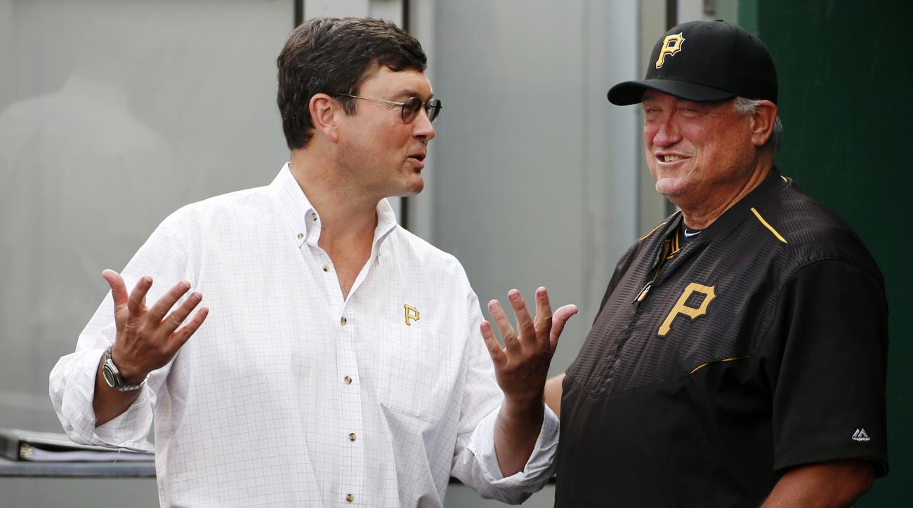 FILE - In this June 9, 2015, file photo, Pittsburgh Pirates manager Clint Hurdle, right, talks with Pirates Chairman of the Board Bob Nutting in the dugout before a baseball game against the Milwaukee Brewers in Pittsburgh. A packed stadium, a roster fill