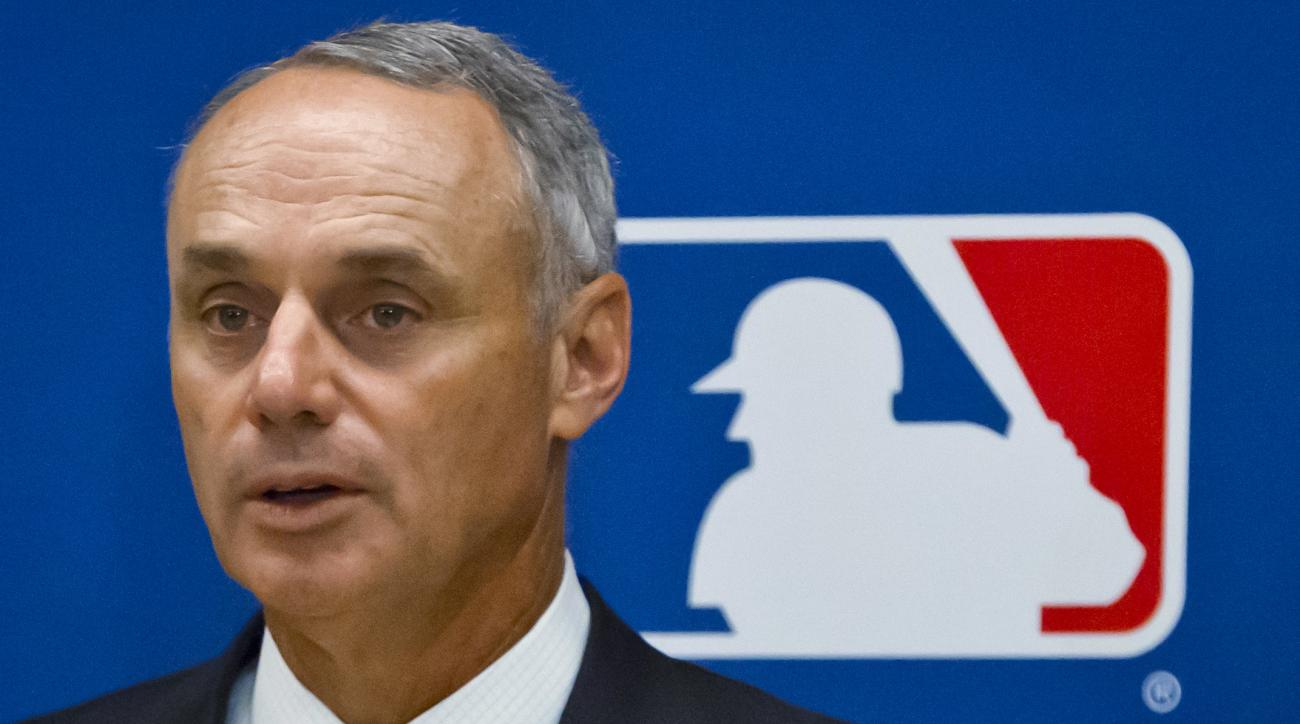 FILE - In this May 21, 2015, file photo, baseball Commissioner Rob Manfred speaks during a news conference in New York. Pete Rose has made his case for reinstatement with Commissioner Rob Manfred, who promised a decision by the end of December. Major Leag