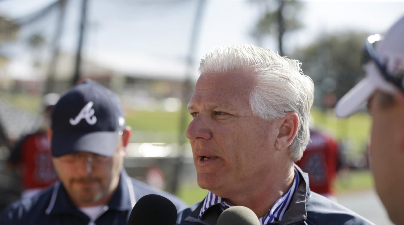 FILE - In this March 11, 2014, file photo, then-Atlanta Braves Executive Vice President and General Manager Frank Wren meets the media before their spring exhibition baseball game against the Philadelphia Phillies in Kissimmee, Fla. The Red Sox have hired