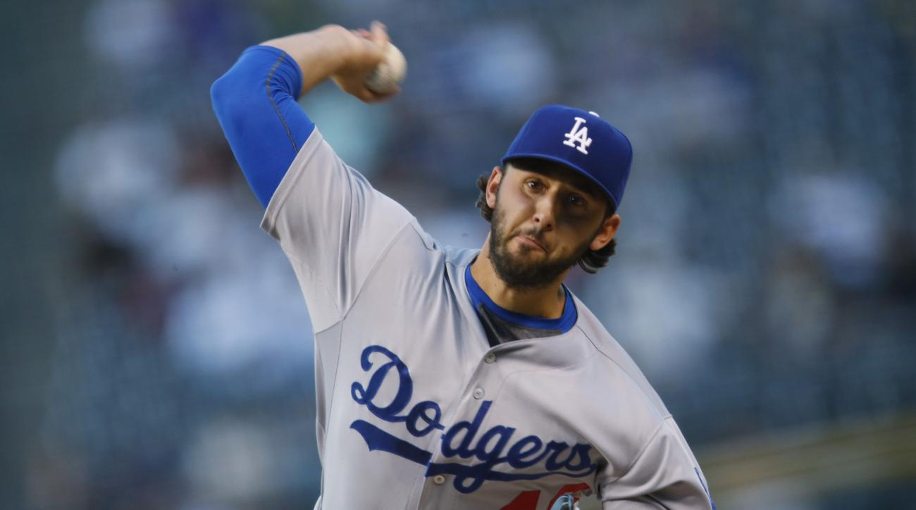 Los Angeles Dodgers starting pitcher Mike Bolsinger works against the Colorado Rockies in the first inning of a baseball game Friday, Sept. 25, 2015, in Denver. (AP Photo/David Zalubowski)