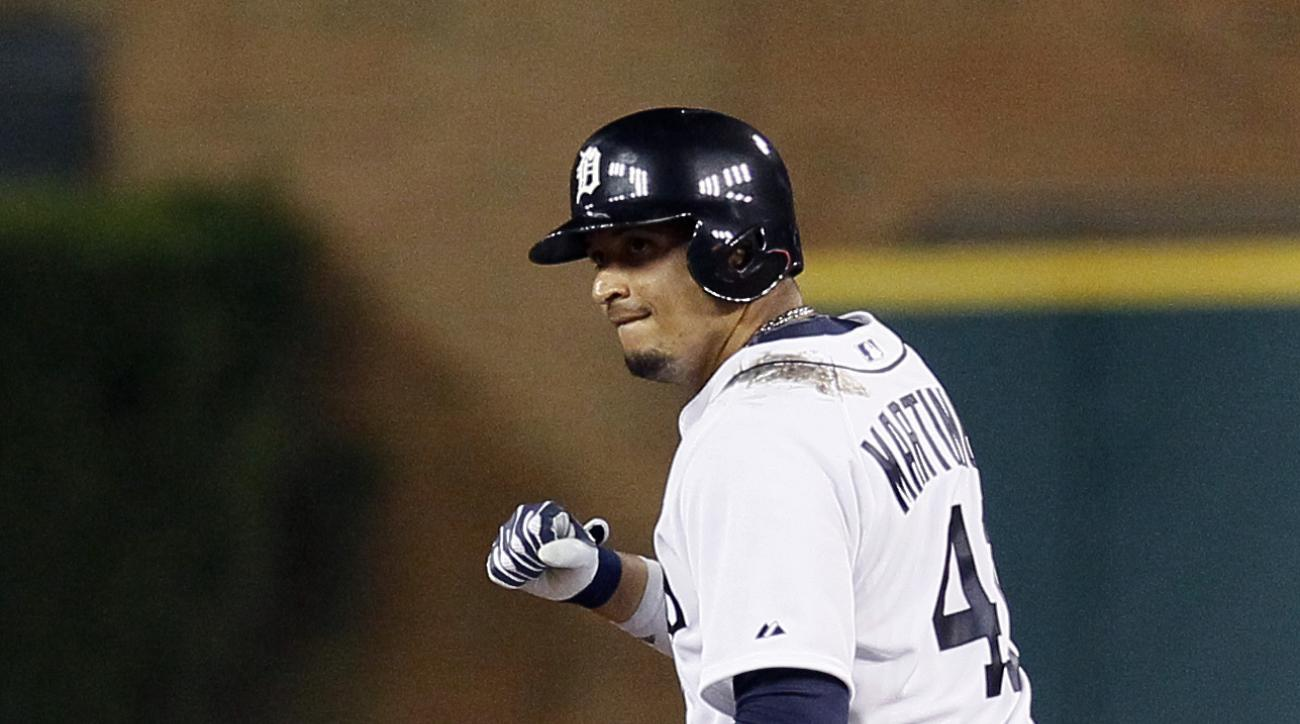 Detroit Tigers' Victor Martinez celebrates at second base after hitting a two-run double against the Minnesota Twins during the seventh inning of a baseball game at Comerica Park, Friday, Sept. 25, 2015, in Detroit. (AP Photo/Duane Burleson)