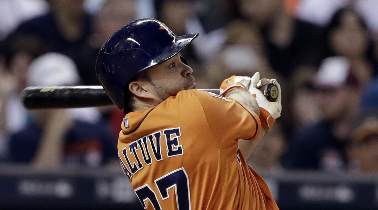 Houston Astros' Jose Altuve flies out to center field against the Texas Rangers in the fourth inning of a baseball game Friday, Sept. 25, 2015, in Houston. (AP Photo/Pat Sullivan)