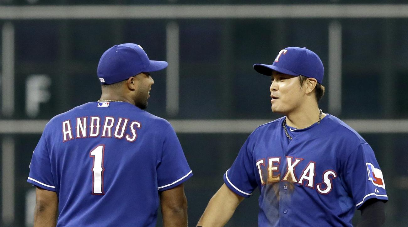 Texas Rangers Elvis Andrus (1) and Shin-Soo Choo celebrate their 6-2 win over the Houston Astros in a baseball game Friday, Sept. 25, 2015, in Houston. (AP Photo/Pat Sullivan)