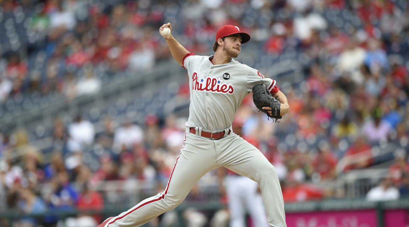 Philadelphia Phillies starting pitcher Aaron Nola delivers a pitch against the Washington Nationals during the first inning of a baseball game, Saturday, Sept. 26, 2015, in Washington. (AP Photo/Nick Wass)