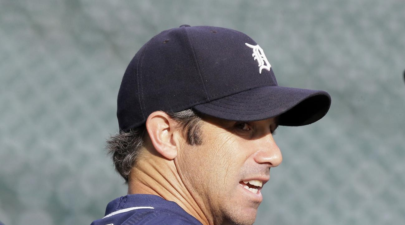 Detroit Tigers manager Brad Ausmus watches batting practice before the game against the Minnesota Twins, Saturday, Sept. 26, 2015 in Detroit. Ausmus is going to return as the Detroit Tigers' manager in 2016. General manager Al Avila made the announcement