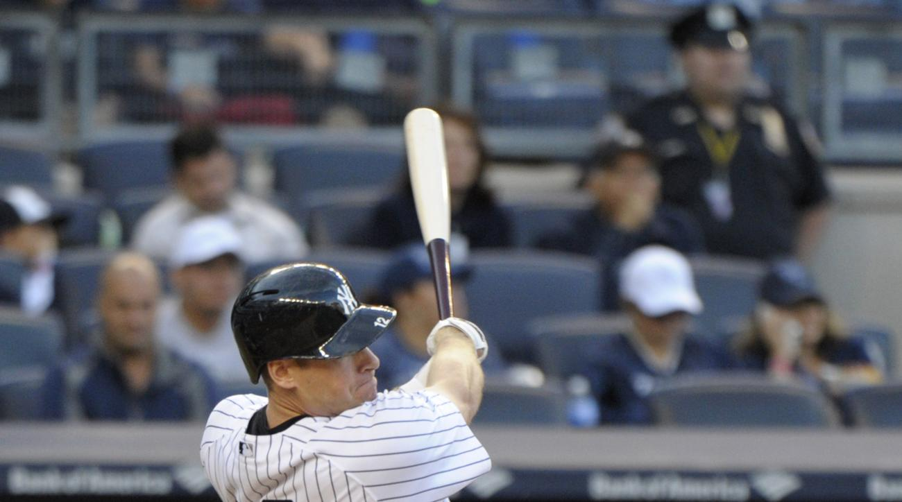 New York Yankees' Chase Headley hits an RBI-double during the sixth inning of a baseball game against the Chicago White Sox, Saturday, Sept. 26, 2015, at Yankee Stadium in New York. (AP Photo/Bill Kostroun)