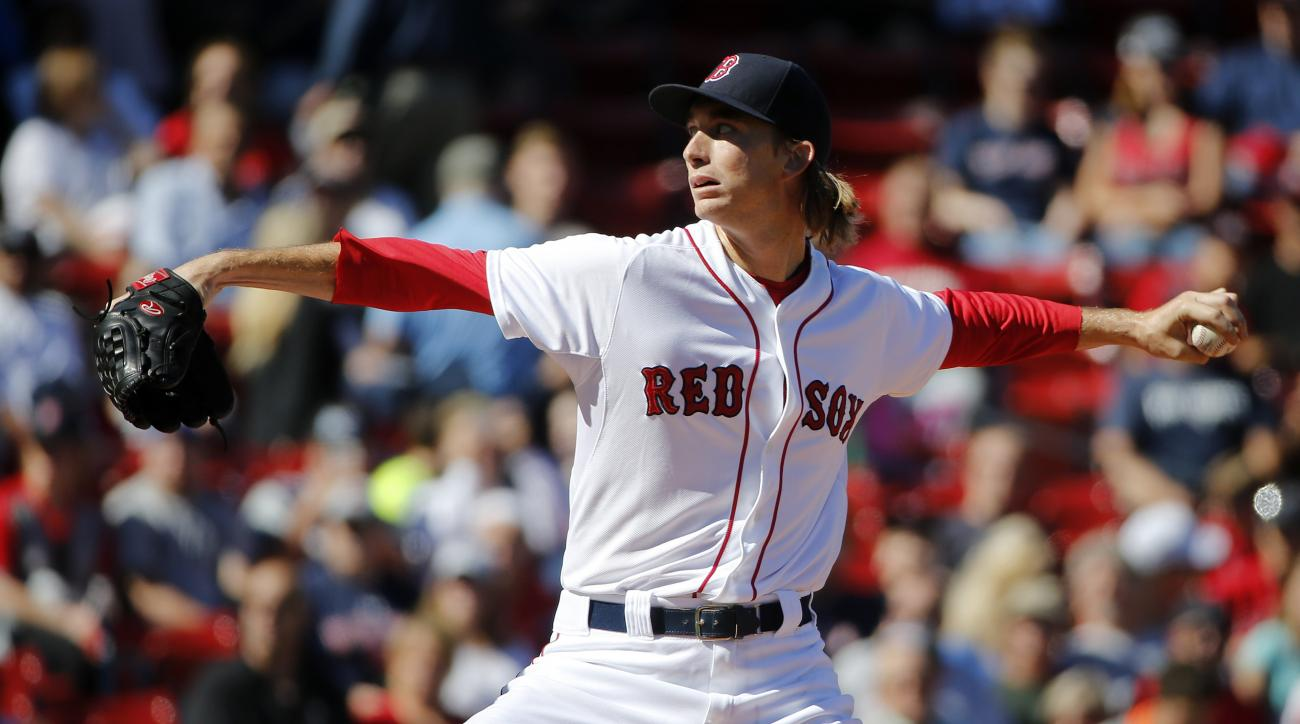 Boston Red Sox's Henry Owens pitches during the first inning of a baseball game against the Baltimore Orioles in Boston, Sunday, Sept. 27, 2015. (AP Photo/Michael Dwyer)