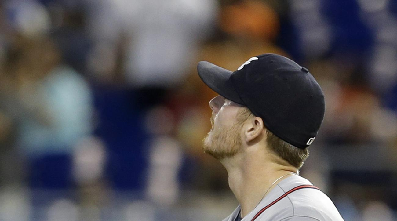 Atlanta Braves' Shelby Miller watches a replay on the giant screen of Miami Marlins' Justin Bour's two-run home run in the first inning of a baseball game, Sunday, Sept. 27, 2015, in Miami. (AP Photo/Alan Diaz)