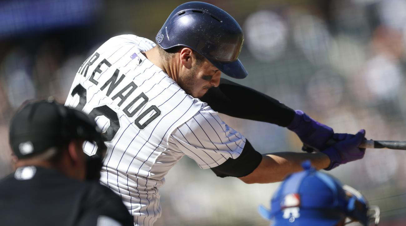 Colorado Rockies' Nolan Arenado grounds out against the Los Angeles Dodgers in the first inning of a baseball game Sunday, Sept. 27, 2015, in Denver. (AP Photo/David Zalubowski)