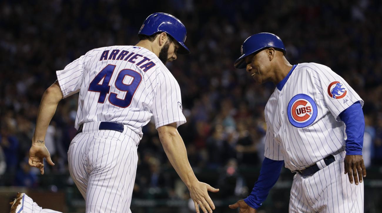 Chicago Cubs starter Jake Arrieta, left, celebrates with third base coach Gary Jones after hitting a solo home run during the second inning of a baseball game against Pittsburgh Pirates, Sunday, Sept. 27, 2015, in Chicago. (AP Photo/Nam Y. Huh)