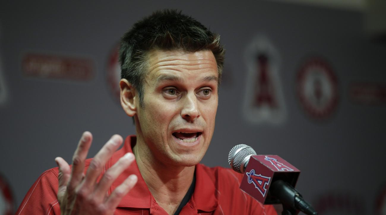 FILE - In this April 3, 2015, file photo, Los Angeles Angels general manager Jerry Dipoto speaks to reporters during a news conference in Anaheim, Calif. Dipoto resigned Wednesday, July 1, 2015, abruptly ending his 3 1/2-year tenure with the club amid app