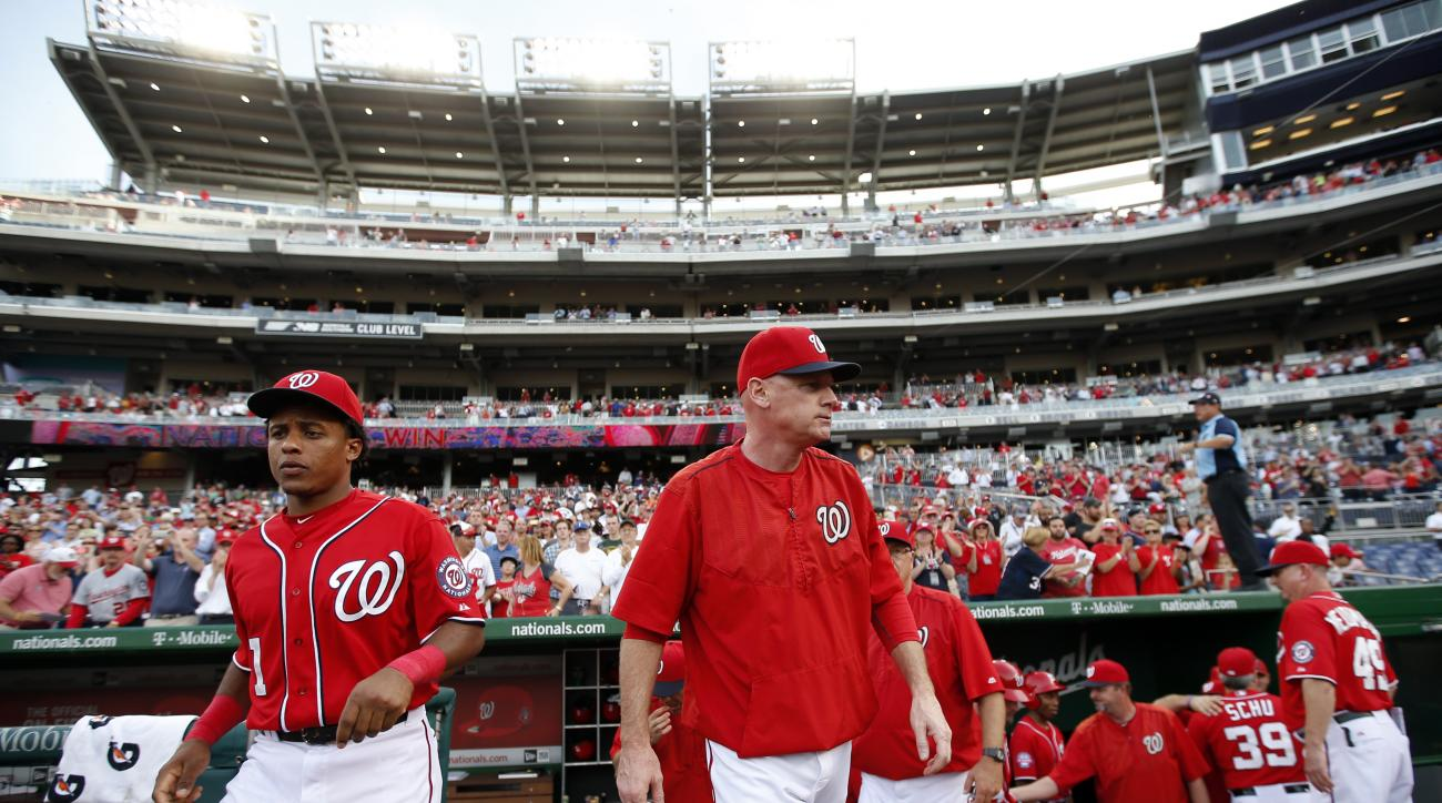 Washington Nationals manager Matt Williams, center, walks out of the dugout after a baseball game against the Cincinnati Reds at Nationals Park, Monday, Sept. 28, 2015, in Washington. The Nationals won 5-1. (AP Photo/Alex Brandon)
