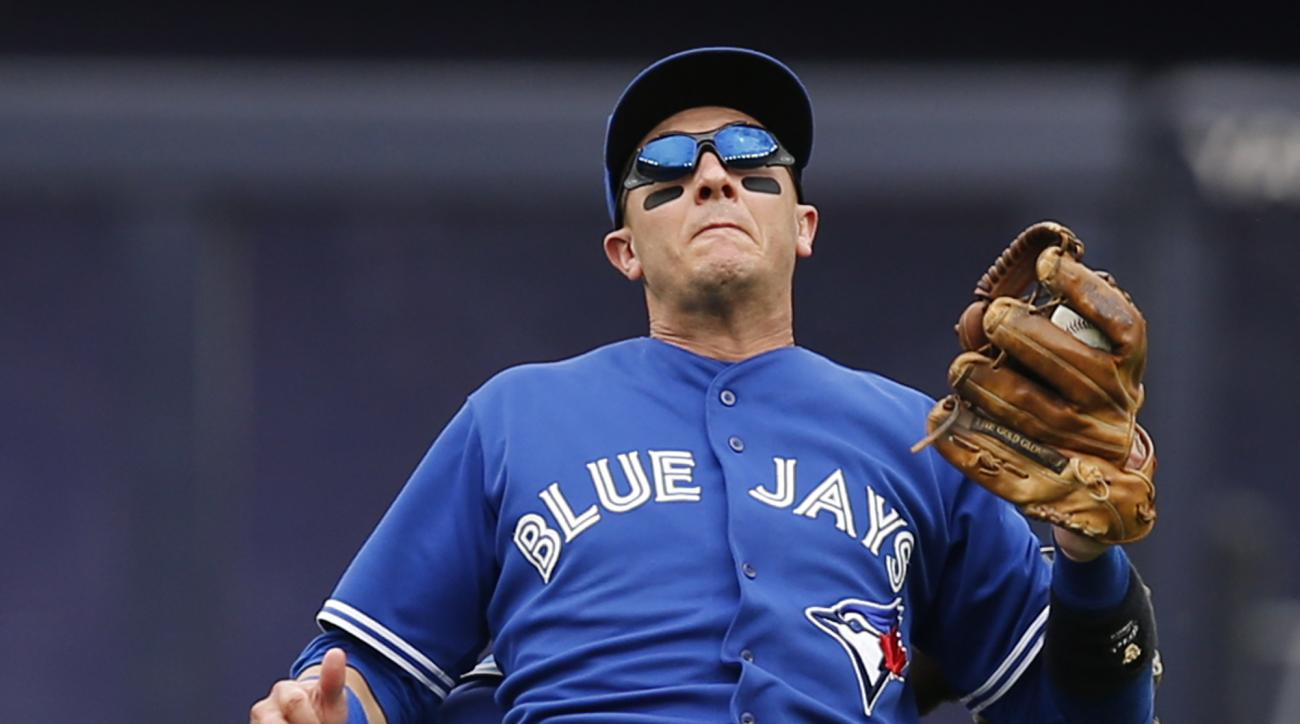 Toronto Blue Jays shortstop Troy Tulowitzki  reacts as he collides with Blue Jays center fielder Kevin Pillar fielding a second-inning fly ball in a baseball game against the New York Yankees at Yankee Stadium in New York, Saturday, Sept. 12, 2015. After