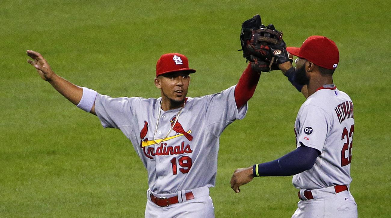 St. Louis Cardinals center fielder Jon Jay (19) and right fielder Jason Heyward (22) celebrate a 3-0 win over the Pittsburgh Pirates in a baseball game in Pittsburgh, Monday, Sept. 28, 2015. (AP Photo/Gene J. Puskar)