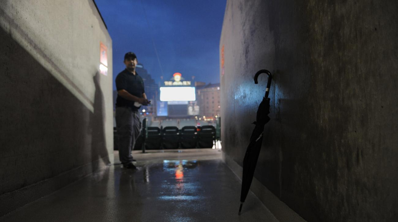 An umbrella sits on the concours after the game between the Baltimore Orioles and Toronto Blue Jays was postponed due to rain Tuesday, Sept. 29, 2015, in Baltimore.(AP Photo/Gail Burton)