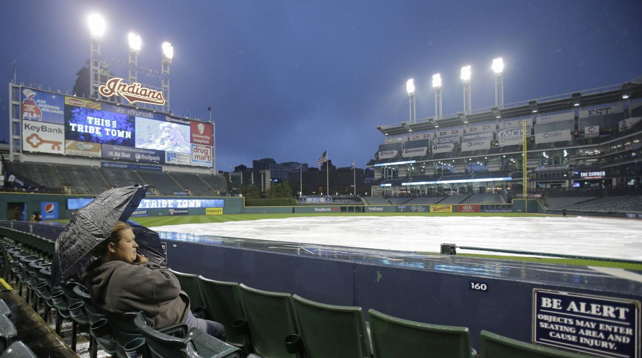 Crystal Smith waits during a rain delay in a baseball game between the Minnesota Twins and the Cleveland Indians, Tuesday, Sept. 29, 2015, in Cleveland. (AP Photo/Tony Dejak)