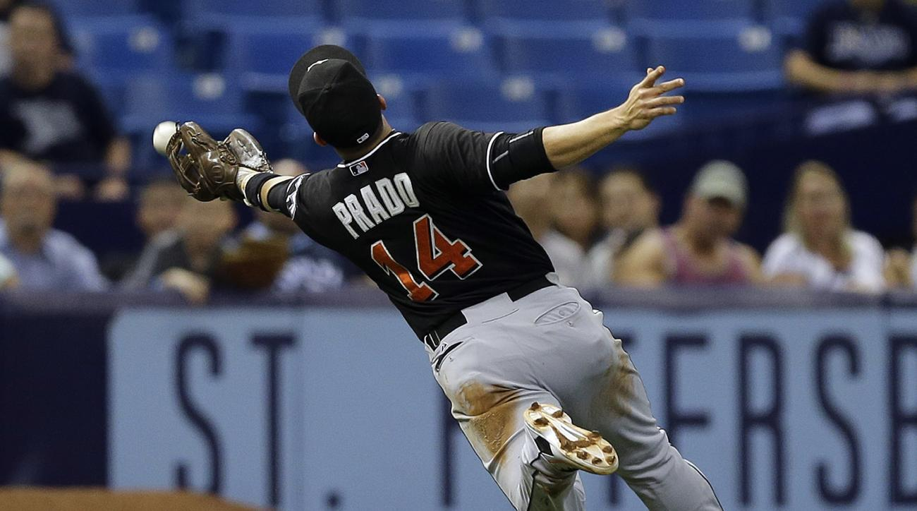 Miami Marlins third baseman Martin Prado can't reach a ball hit for a single by Tampa Bay Rays' James Loney during the fourth inning of an interleague baseball game Tuesday, Sept. 29, 2015, in St. Petersburg, Fla. (AP Photo/Chris O'Meara)