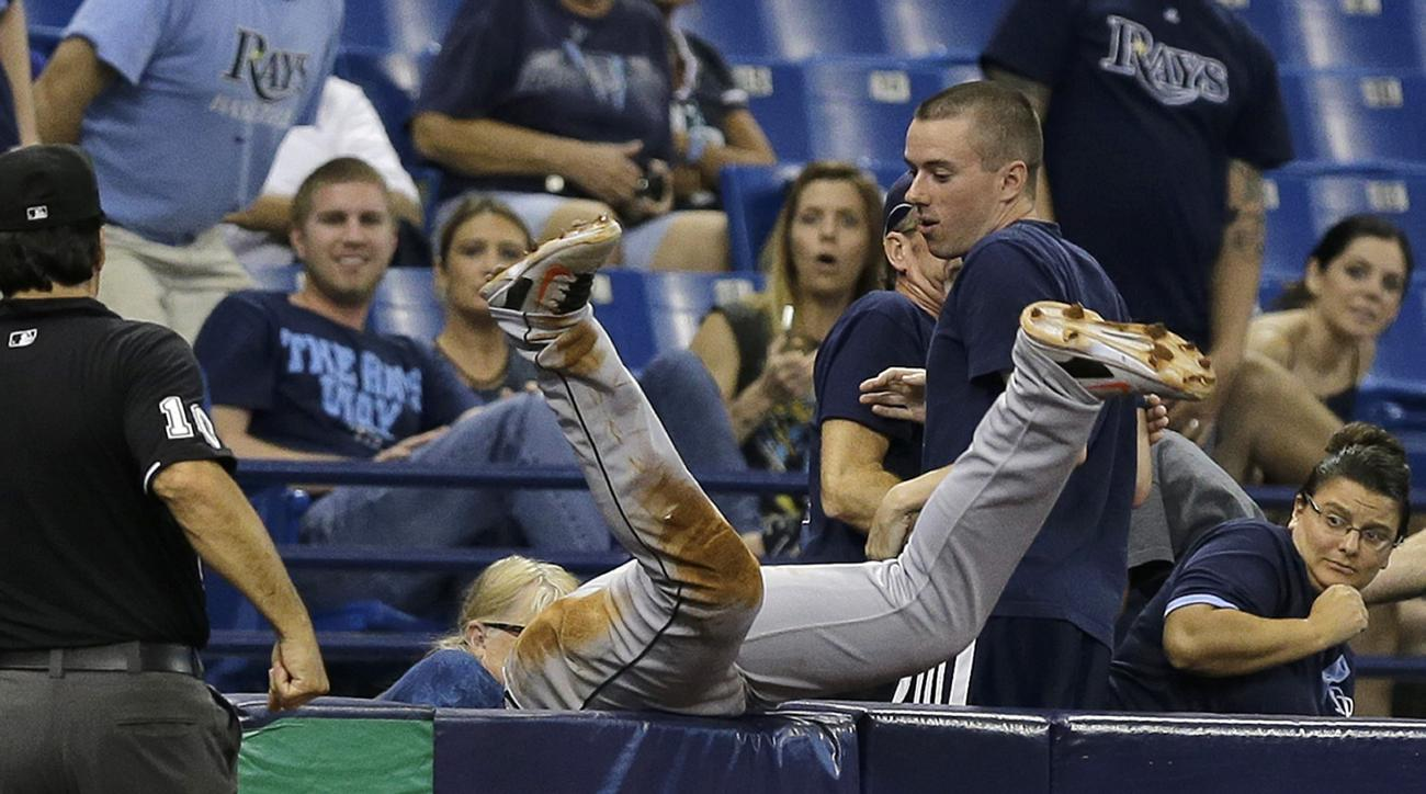 Miami Marlins third baseman Martin Prado goes into the stands to make a catch on a pop out by Tampa Bay Rays' Mikie Mahtook during the seventh inning of an interleague baseball game Tuesday, Sept. 29, 2015, in St. Petersburg, Fla. (AP Photo/Chris O'Meara)