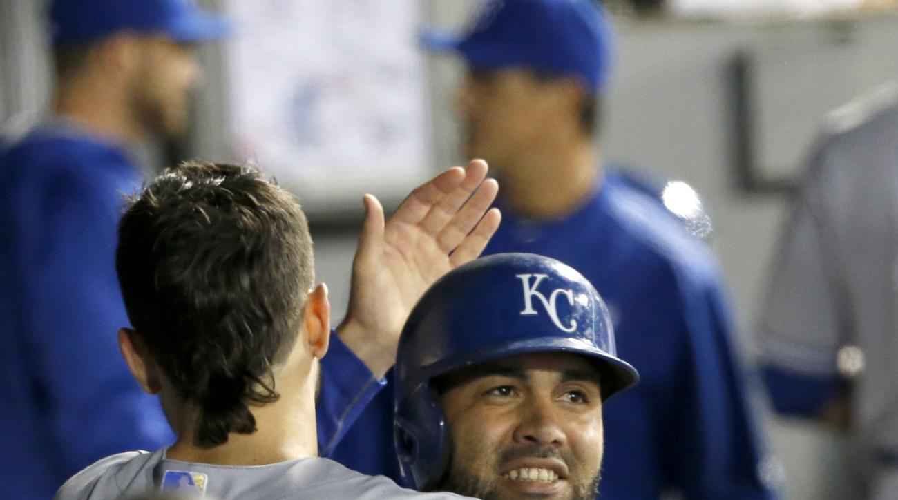 Kansas City Royals' Kendrys Morales smiles after a hug from Eric Hosmer, as they both celebrate Morales' home run off Chicago White Sox pitcher Jeff Samardzija, during the sixth inning of a baseball game Tuesday, Sept. 29, 2015, in Chicago. (AP Photo/Char
