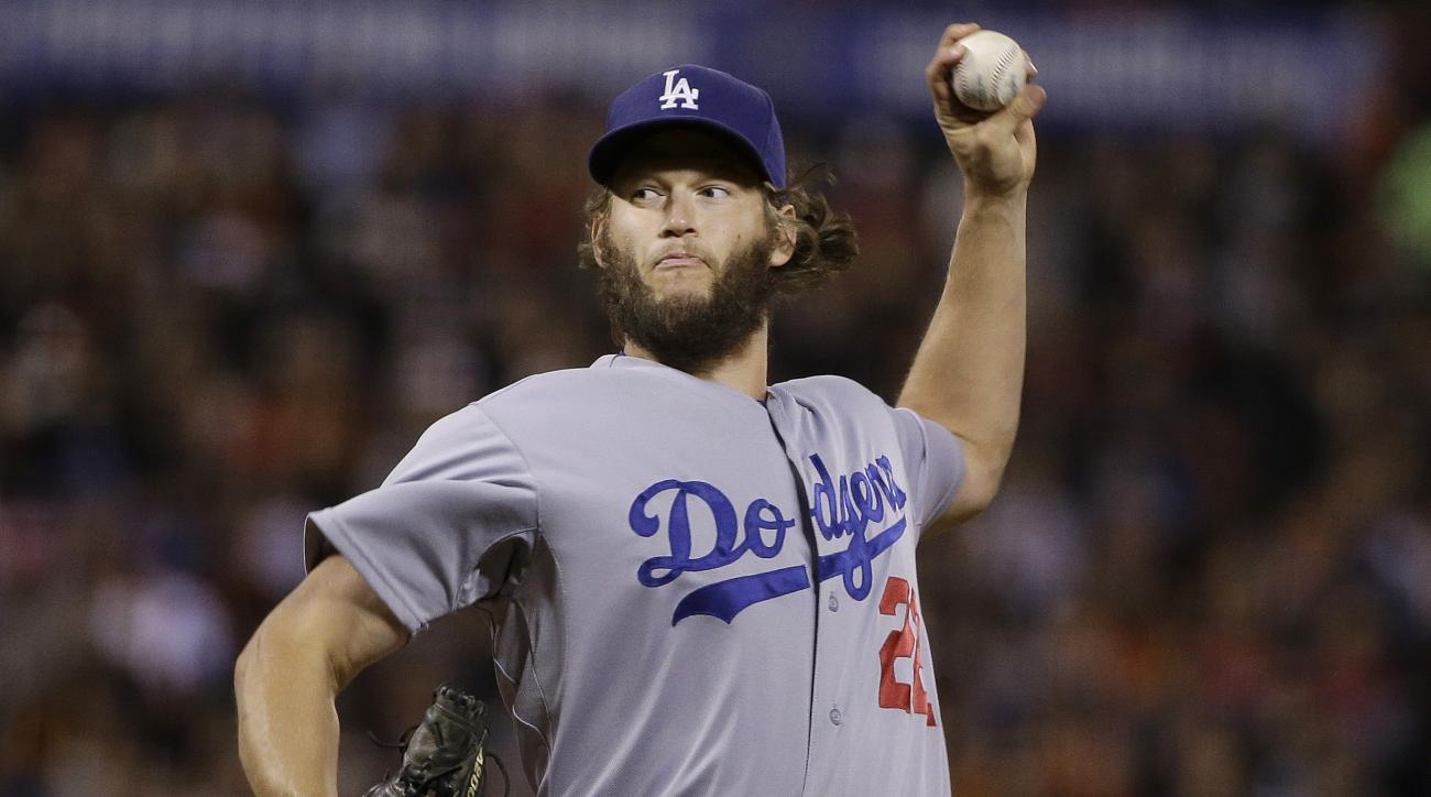 Los Angeles Dodgers pitcher Clayton Kershaw throws against the San Francisco Giants during the second inning of a baseball game in San Francisco, Tuesday, Sept. 29, 2015. (AP Photo/Jeff Chiu)