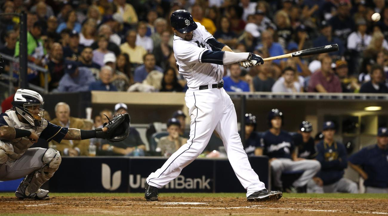 San Diego Padres' Tyson Ross hits in the fourth inning of a baseball game against the Milwaukee Brewers, Tuesday, Sept. 29, 2015, in San Diego.  (AP Photo/Lenny Ignelzi)