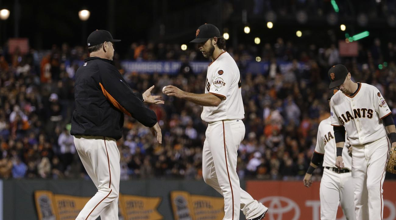 San Francisco Giants manager Bruce Bochy, left, takes the ball from pitcher Madison Bumgarner as he takes him out for a relief pitcher during the sixth inning of a baseball game against the Los Angeles Dodgers in San Francisco, Tuesday, Sept. 29, 2015. (A