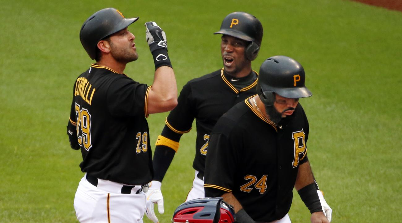 Pittsburgh Pirates' Francisco Cervelli, left,  celebrates with teammates Andrew McCutchen, center, and Pedro Alvarez  after hitting a grand slam off St. Louis Cardinals starting pitcher Michael Wacha in the fourth inning of a baseball game in Pittsburgh,