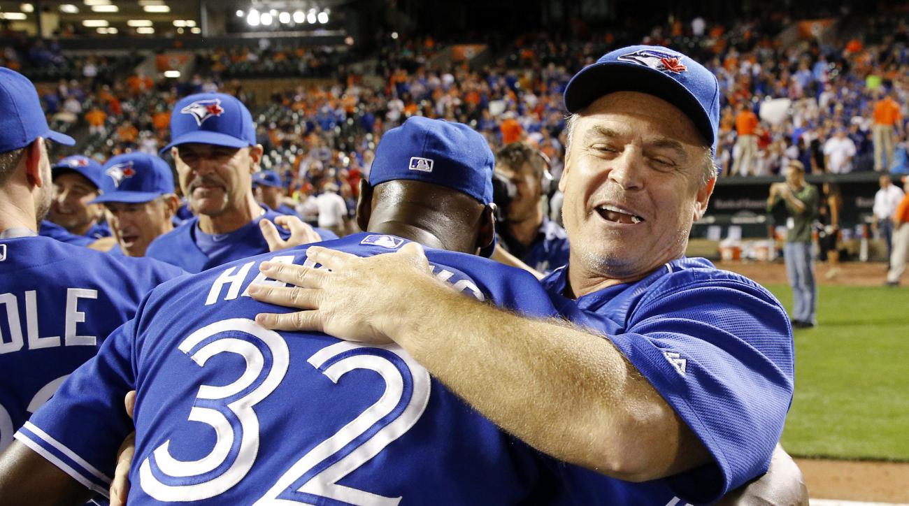 Toronto Blue Jays manager John Gibbons, right, celebrates with relief pitcher LaTroy Hawkins after winning the first baseball game of a doubleheader against the Baltimore Orioles, Wednesday, Sept. 30, 2015, in Baltimore. Toronto won 15-2 to clinch the Ame