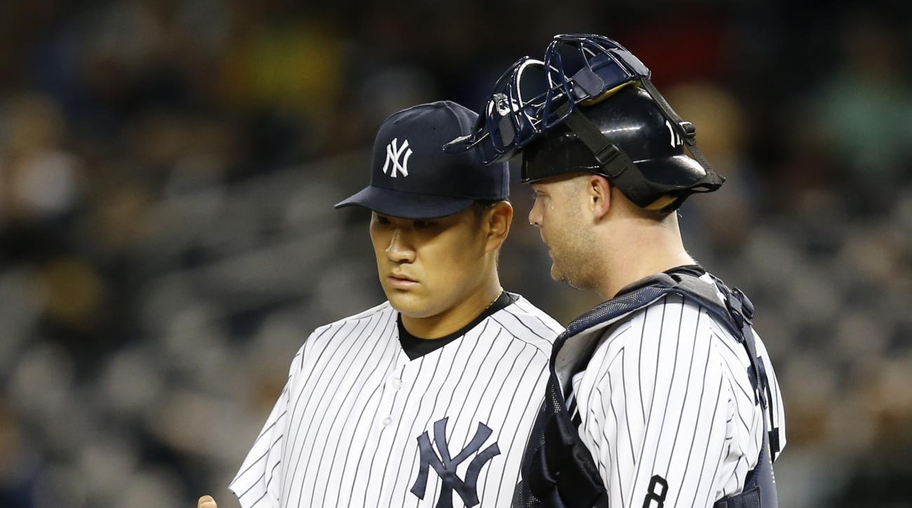 New York Yankees catcher Brian McCann talks to pitcher Masahiro Tanaka after Tanaka allowed a three-run home run to Boston Red Sox Travis Shaw during the first inning of a baseball game in New York, Wednesday, Sept. 30, 2015.   (AP Photo/Kathy Willens)