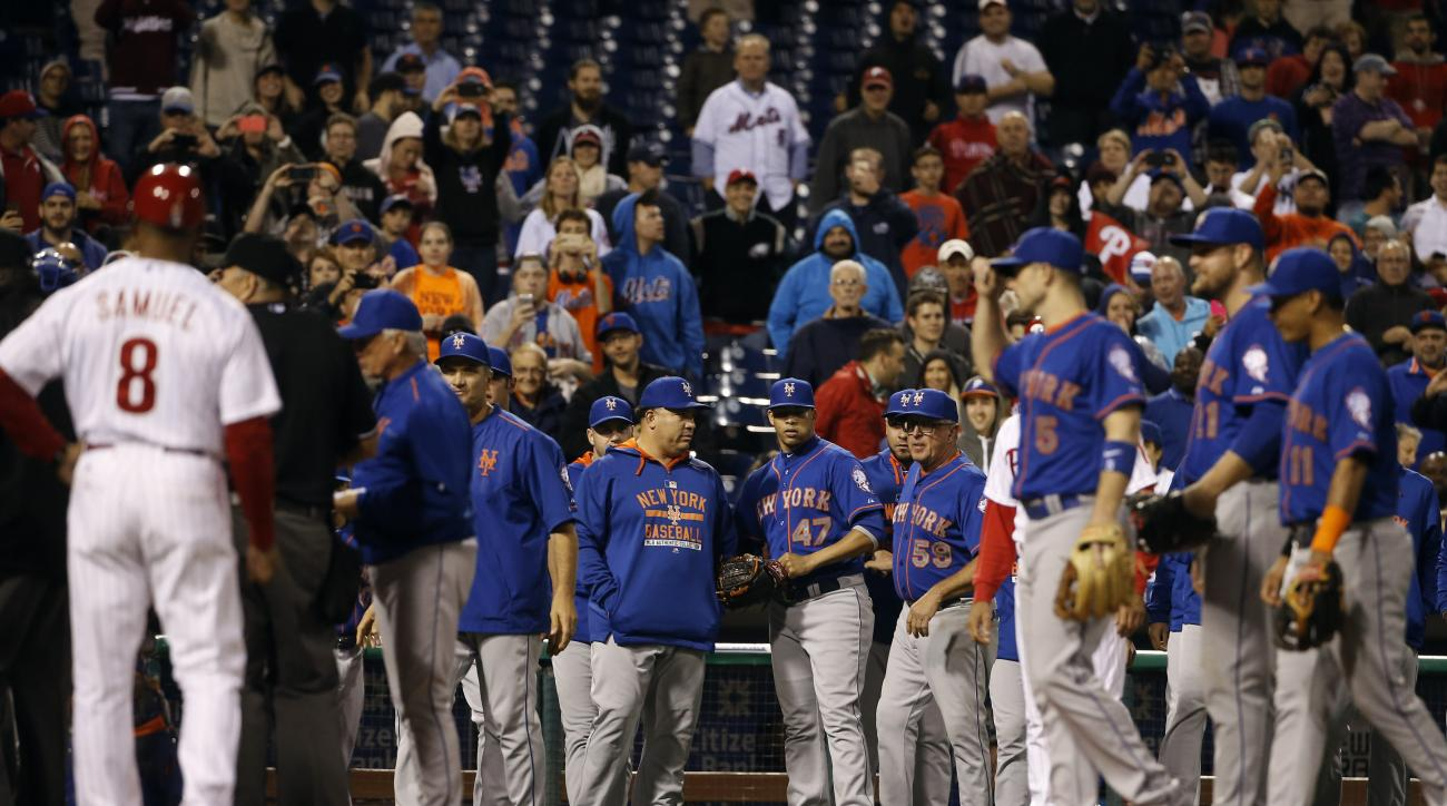 New York Mets relief pitcher Hansel Robles (47) looks back to the field after being ejected for nearly hitting Philadelphia Phillies' Cameron Rupp during the sixth inning of a baseball game, Wednesday, Sept. 30, 2015, in Philadelphia. (AP Photo/Matt Slocu