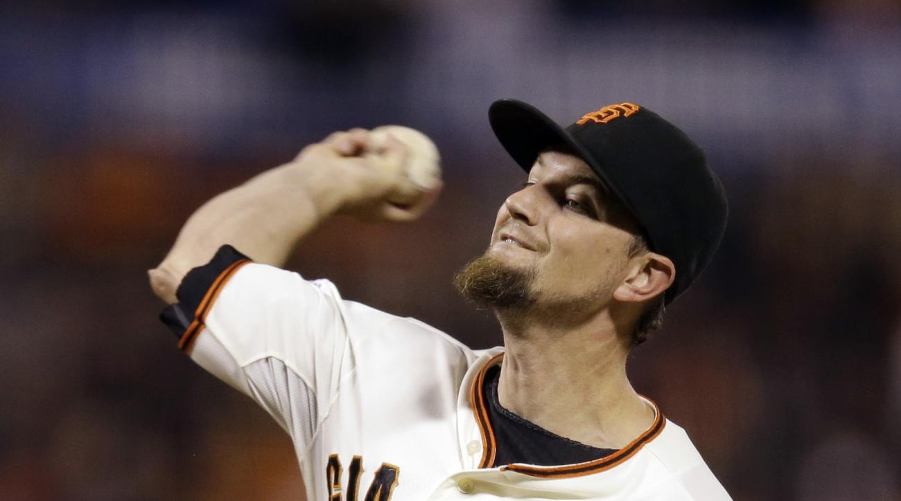 San Francisco Giants pitcher Mike Leake works against the Los Angeles Dodgers in the first inning of a baseball game Wednesday, Sept. 30, 2015, in San Francisco. (AP Photo/Ben Margot)