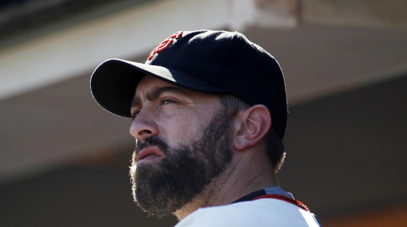 San Francisco Giants pitcher Jeremy Affeldt looks on from the dugout during the ninth inning of a baseball game against the Arizona Diamondbacks, Sunday, Sept. 20, 2015, in San Francisco. (AP Photo/George Nikitin)