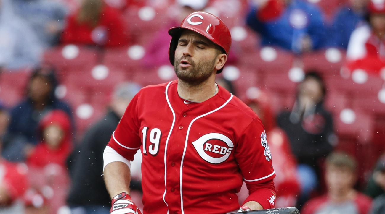 Cincinnati Reds' Joey Votto reacts after striking out in the third inning of a baseball game against the Chicago Cubs, Thursday, Oct. 1, 2015, in Cincinnati. (AP Photo/John Minchillo)