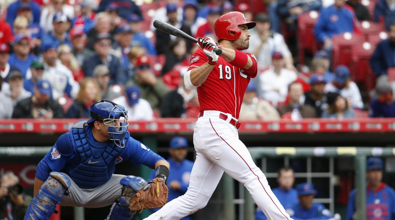Cincinnati Reds' Joey Votto hits an RBI single off Chicago Cubs relief pitcher Fernando Rodney in the seventh inning of a baseball game, Thursday, Oct. 1, 2015, in Cincinnati. (AP Photo/John Minchillo)