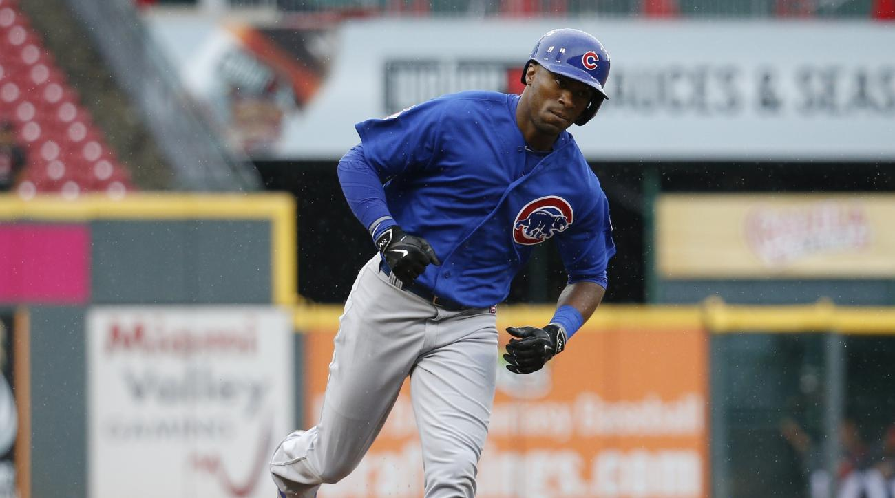 Chicago Cubs' Austin Jackson rounds third on a three-run home run off Cincinnati Reds starting pitcher John Lamb in the third inning of a baseball game, Thursday, Oct. 1, 2015, in Cincinnati. (AP Photo/John Minchillo)