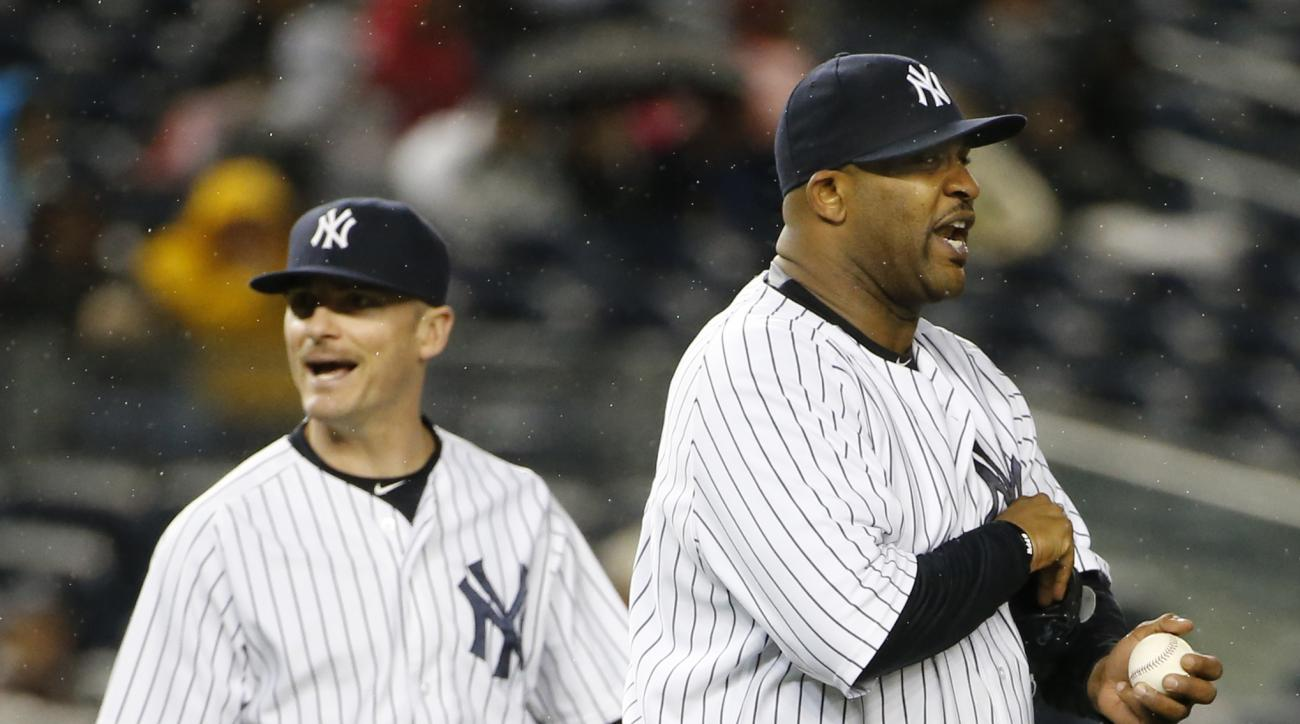 New York Yankees starting pitcher CC Sabathia, right, and teammate Brendan Ryan react after the Yankees completed a double play in the fourth inning of a baseball game in New York, Thursday, Oct. 1, 2015.   (AP Photo/Kathy Willens)