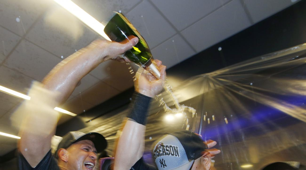 New York Yankees designated hitter Alex Rodriguez, left, pours champagne on New York Yankees Carlos Beltran after the Yankees clinched a wild card berth in the playoffs after defeating the Boston Red Sox 4-1 in a baseball game in New York, Thursday, Oct.