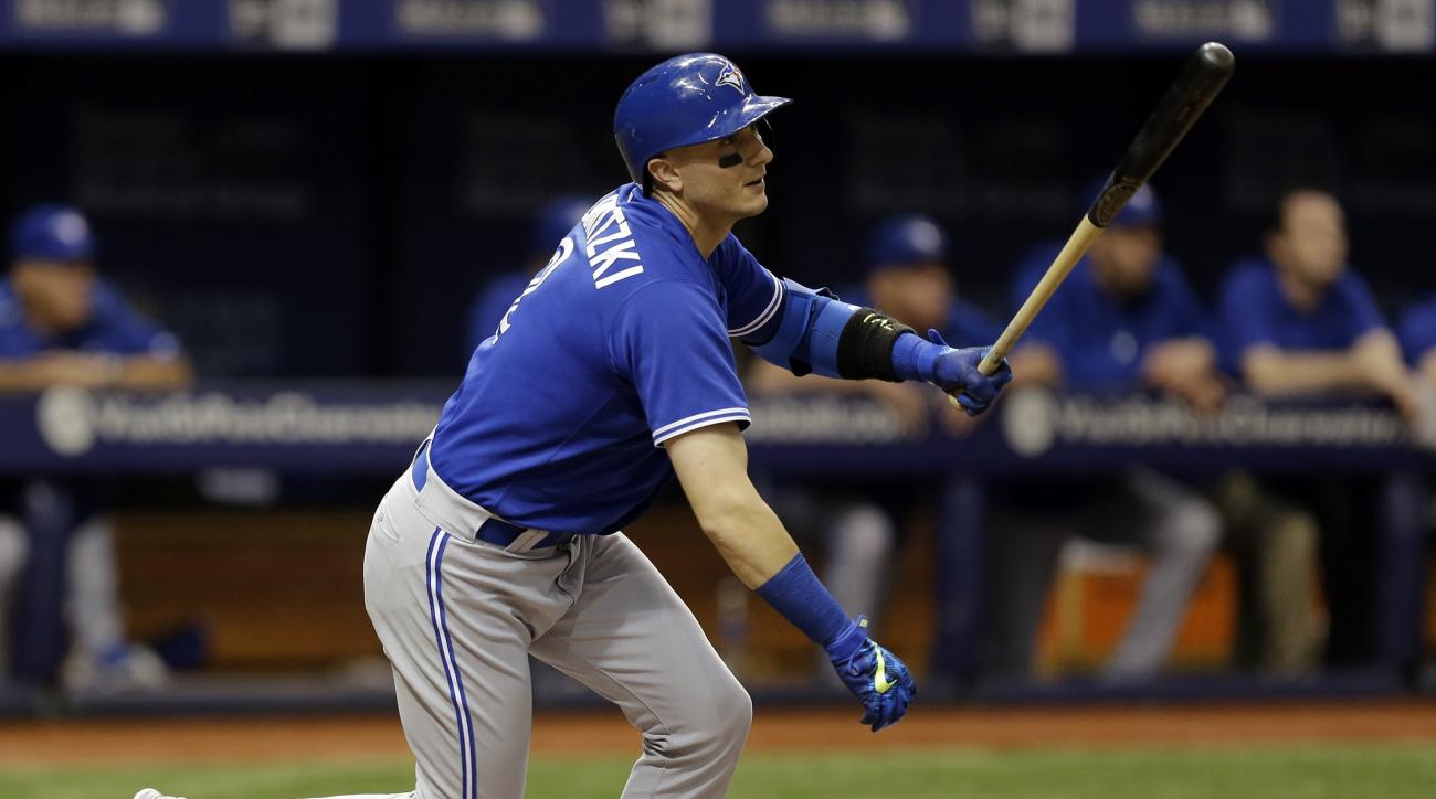 Toronto Blue Jays' Troy Tulowitzki flies out to Tampa Bay Rays right fielder Mikie Mahtook during the second inning of a baseball game Friday, Oct. 2, 2015, in St. Petersburg, Fla.  Tulowitzki, who hasn't played since Sept. 12 after a collision with teamm