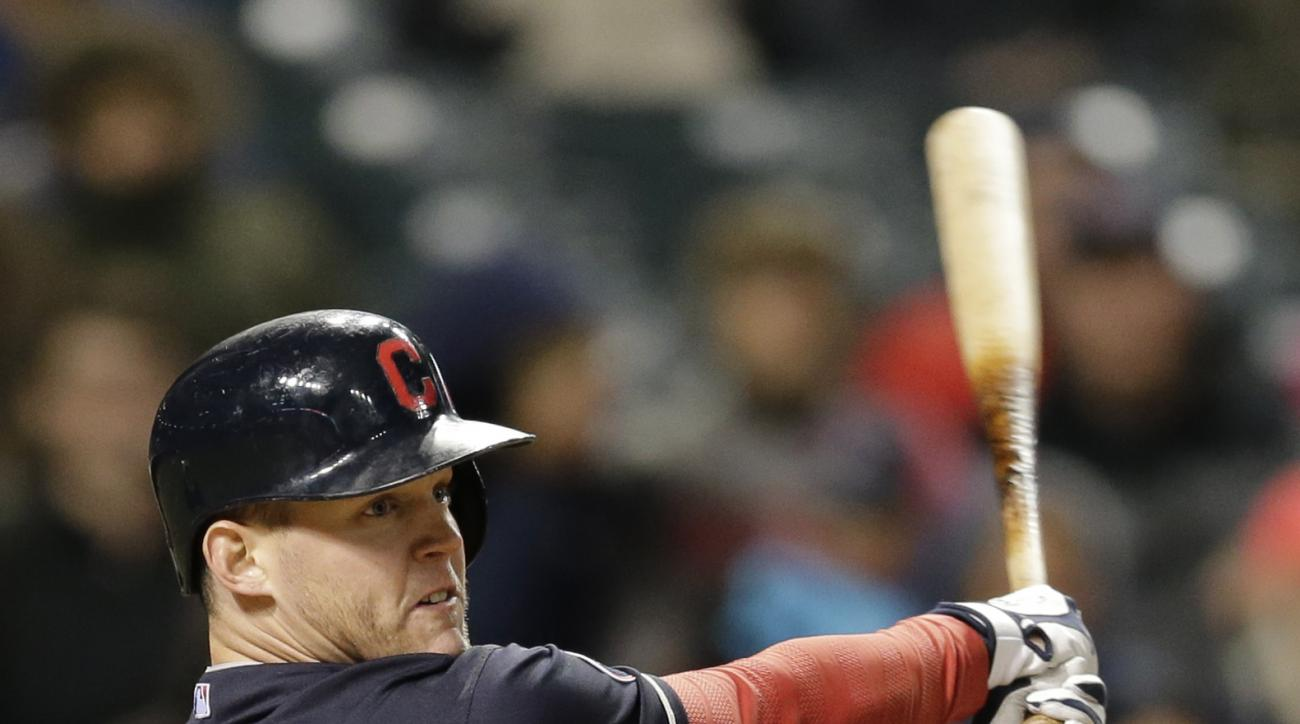 Cleveland Indians' Jerry Sands hits a solo home run off Boston Red Sox relief pitcher Jonathan Aro in the seventh inning of a baseball game, Friday, Oct. 2, 2015, in Cleveland. (AP Photo/Tony Dejak)