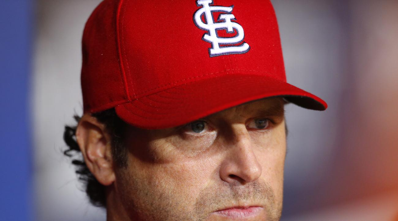 St. Louis Cardinals manager Mike Matheny watches on from the dugout in the fifth inning of a baseball game against the Atlanta Braves, Friday, Oct. 2, 2015, in Atlanta. (AP Photo/Todd Kirkland)