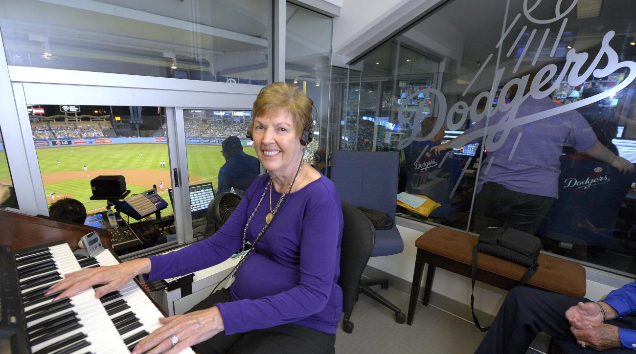 Los Angeles Dodgers organist Nancy Bea Hefley poses at her organ during the second inning of a baseball game between the  Dodgers and the San Diego Padres, Friday, Oct. 2, 2015, in Los Angeles. Hefley, whose organ has provided the musical backdrop to the