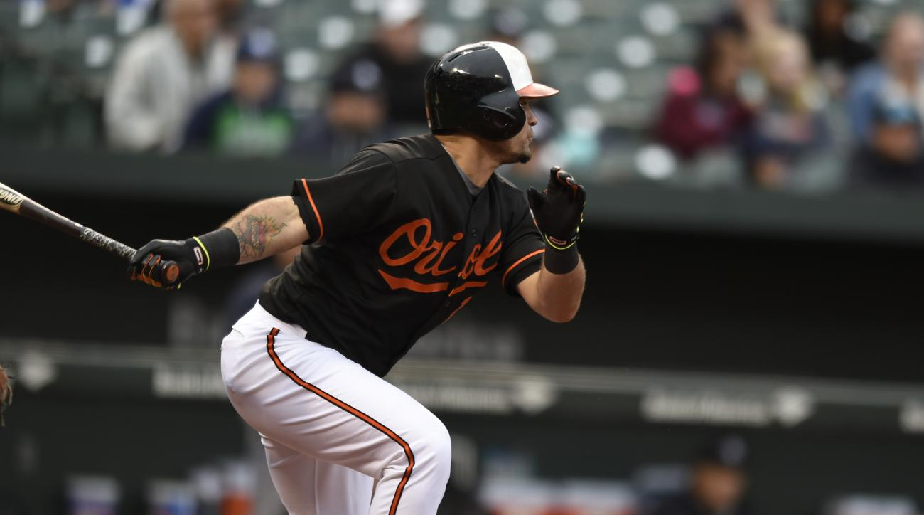 Baltimore Orioles' Gerardo Parra follows through with a double against the New York Yankees in the third inning of the first baseball game of a doubleheader in Baltimore, Saturday, Oct. 3, 2015. (AP Photo/Gail Burton)