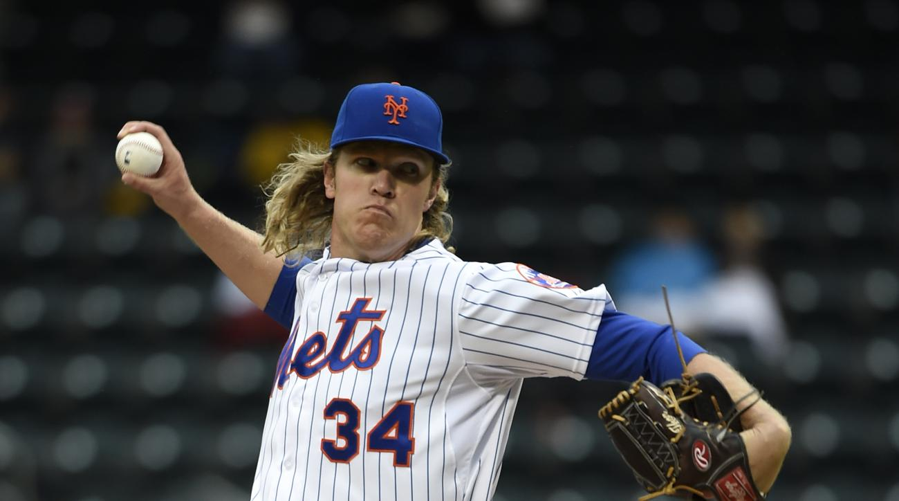 New York Mets starting pitcher Noah Syndergaard (34) delivers against the Washington Nationals in the first inning of the first baseball game of a doubleheader, Saturday, Oct. 3, 2015, in New York. (AP Photo/Kathy Kmonicek)