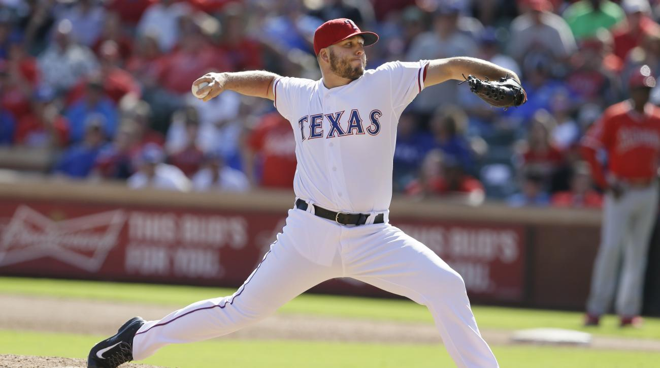 Texas Rangers closer Shawn Tolleson throws during the ninth inning of a baseball game against the Los Angeles Angels in Arlington, Texas, Saturday, Oct. 3, 2015. (AP Photo/LM Otero)