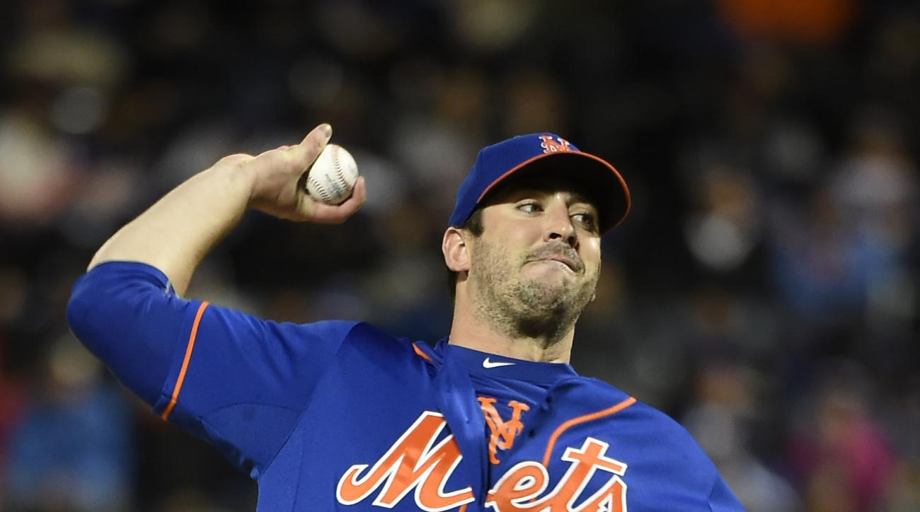 New York Mets starter Matt Harvey (33) pitches against the Washington Nationals  in the first inning of the second baseball game of a doubleheader, Saturday, Oct. 3, 2015, in New York. (AP Photo/Kathy Kmonicek)