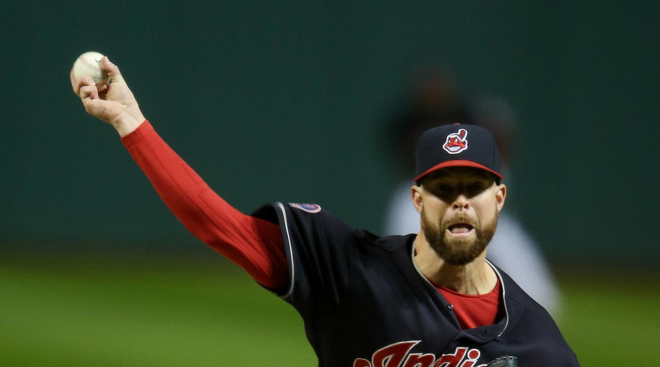 Cleveland Indians starting pitcher Corey Kluber delivers against the Boston Red Sox during the first inning of a baseball game, Saturday, Oct. 3, 2015, in Cleveland. (AP Photo/Ron Schwane)