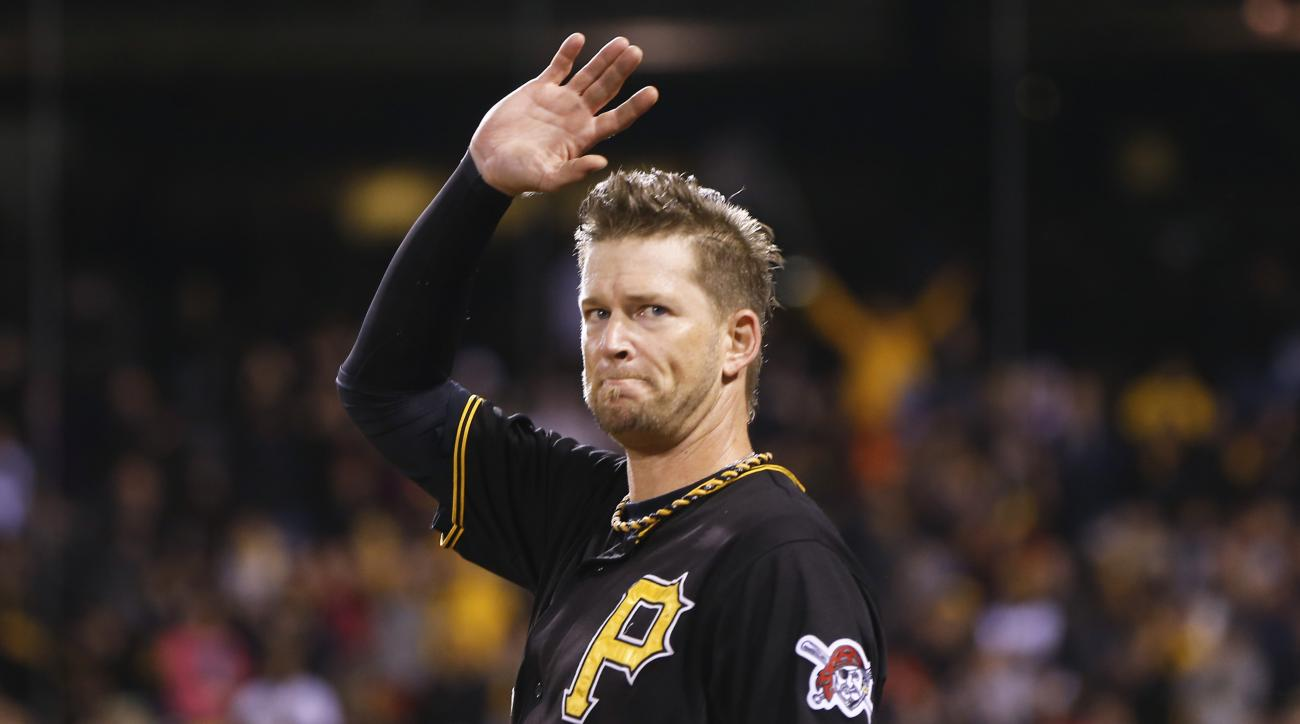 Pittsburgh Pirates starting pitcher A.J. Burnett (34) waves to the fans after being lifted in the seventh inning of a baseball game against the Cincinnati Reds, Saturday, Oct. 3, 2015, in Pittsburgh. This was Burnett's last start in regular season as he h