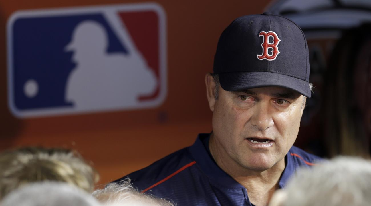 Boston Red Sox manager John Farrell talks to reporters before an interleague baseball game against the Miami Marlins, Tuesday, Aug. 11, 2015, in Miami. (AP Photo/Alan Diaz)