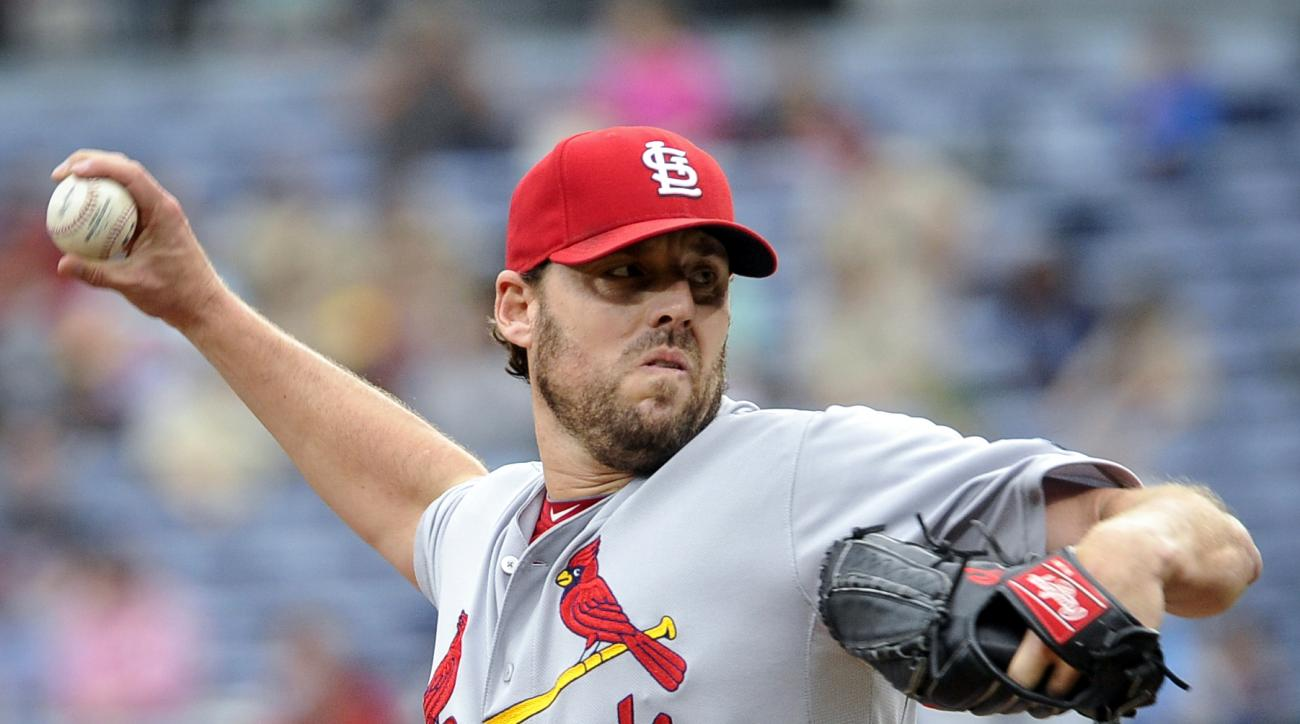 St. Louis Cardinals' John Lackey delivers a pitch during the first inning of the first baseball game of a doubleheader against the Atlanta Braves, Sunday, Oct. 4, 2015, in Atlanta. (AP Photo/John Amis)