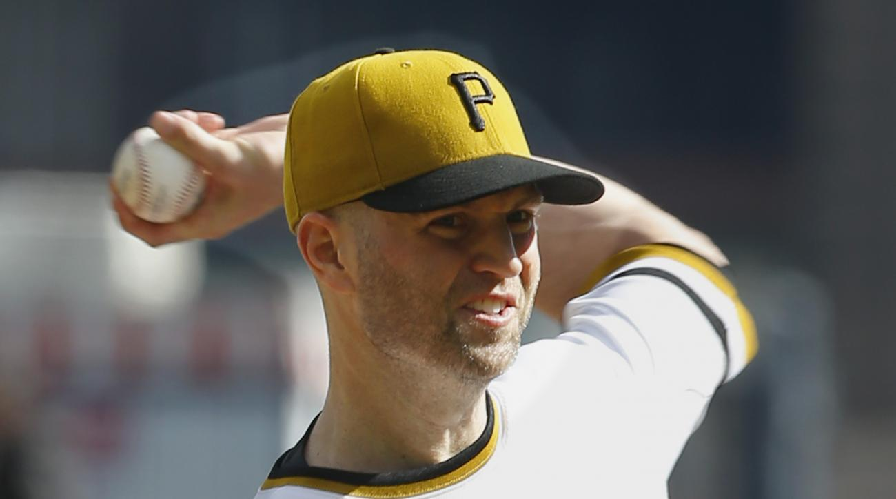 Pittsburgh Pirates starting pitcher J.A. Happ throws against the Cincinnati Reds in the first inning of a baseball game, Sunday, Oct. 4, 2015, in Pittsburgh. (AP Photo/Keith Srakocic)